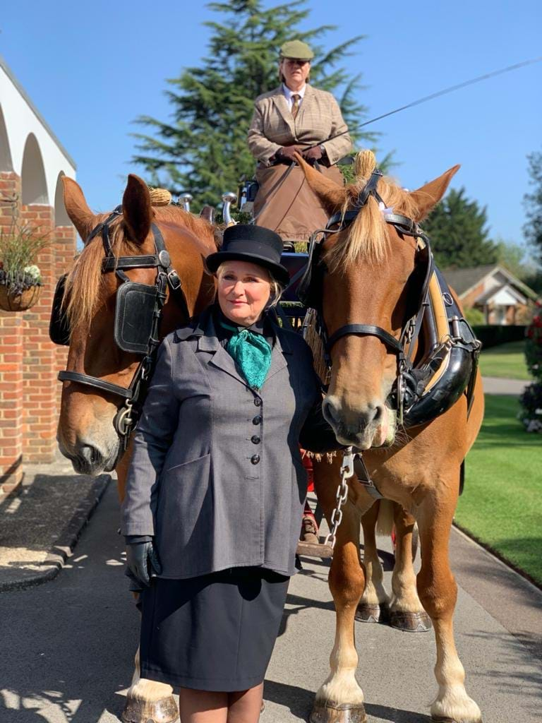Louise stood with the horses from Horsedrawn Occasions